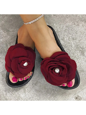 BERRYLOOK / Fashion lady with big flower sandals