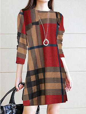 Le donne di Moda di Plaid Dress