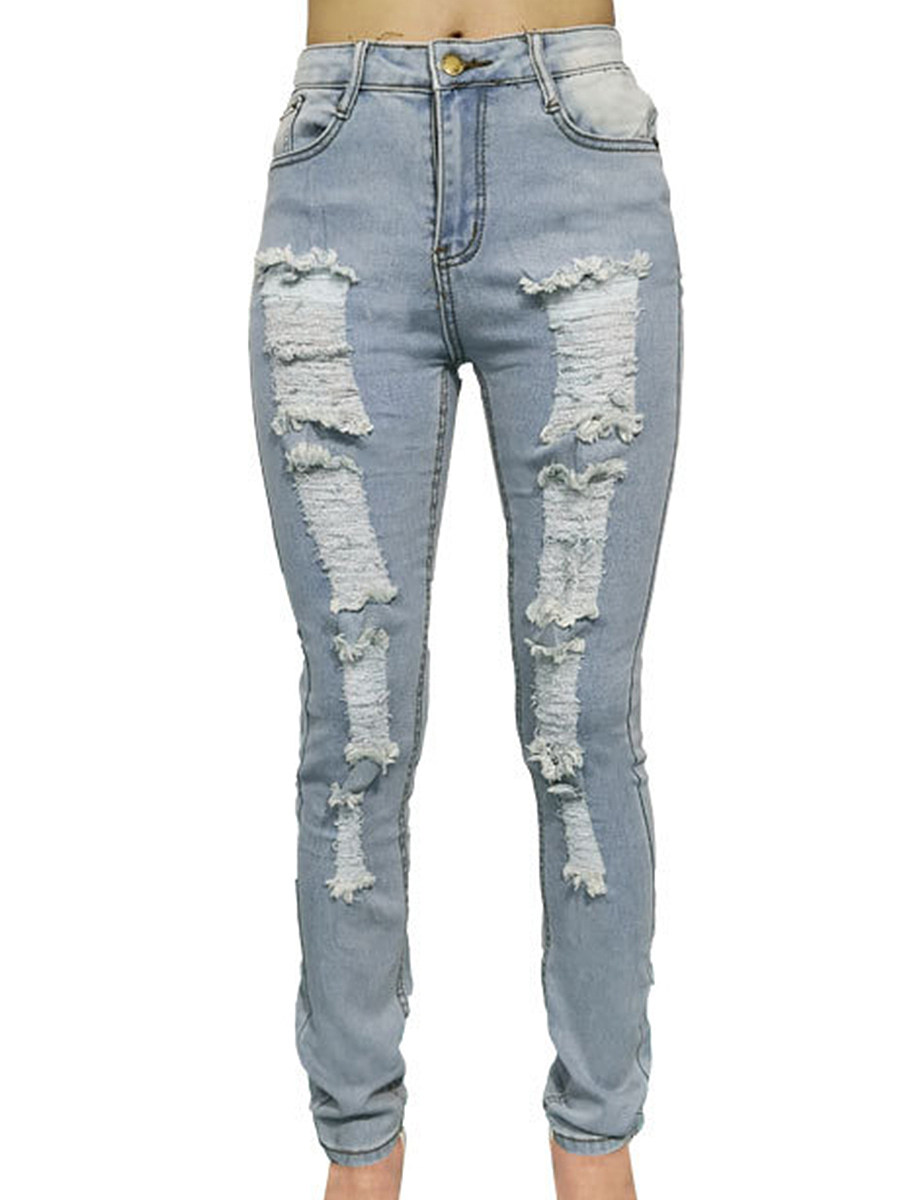 Denim jeans with large holes