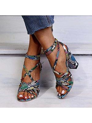 Snakeskin heeled sandals фото
