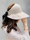 Image of New hat female summer woven sunscreen empty top hat bowknot Korean version of the tide travel foldable wild sun hat